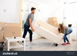 happy couple student roommate packing stock photo 702013735