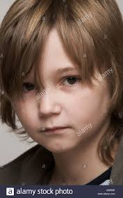 portrait of 11 year boy with hair stock photo royalty