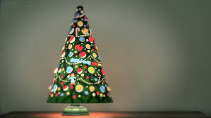an antique christmas tree lamp spins from the heat given off by
