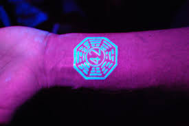 18 stunning black light responsive tattoos mental floss