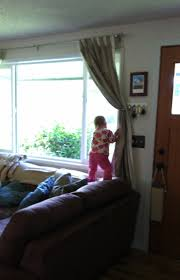letting toddlers climb teetering on the balance of exploration