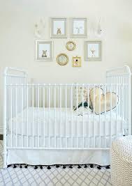 white vintage crib with gold pillows and black tassel skirt