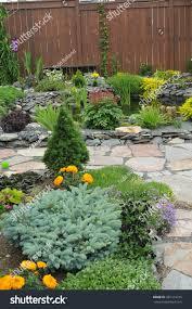garden design featuring garden pond flagstone stock photo