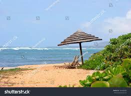 Beach Lounge Chair Umbrella Tiki Beach Umbrella Lounge Chairs Tropical Stock Photo 104498909