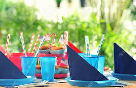 plastic ware table setting with plastic ware for summer picnic stock photo