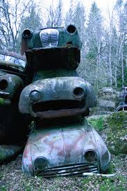 car junkyard netherlands nature reclaiming remote swedish junkyard and bygone cars