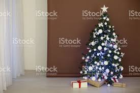 christmas tree with garlands on brown white background new year