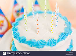 simple white birthday cake with cake candles stock photo royalty