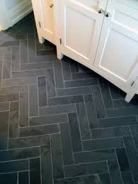 beautiful black slate tile flooring in bathroom laid in a