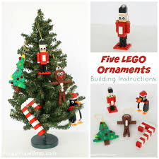 five lego ornaments with building