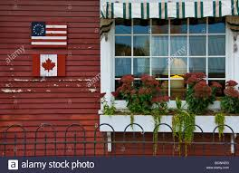 American State Flags House With Canadian And American Flags In Vermont State Stock