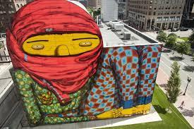 mural colorido de os gêmeos provoca controvérsia em boston haus