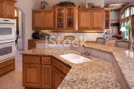 oak cabinets with granite custom luxury eatin kitchen with granite counters oak cabinets stock