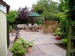 small french courtyard gardens planted with shrubs and small trees