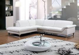 Modern White Rug White Leather Sofa With L Shape And Silver Steel Legs On The Brown