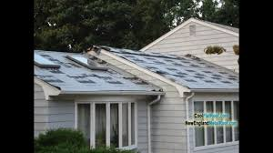 laying metal roofing over shingles