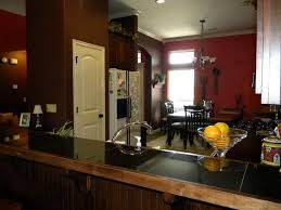 attractive color schemes for living room and kitchen with red and