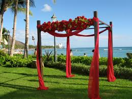 decorating an arbor for a fall wedding the wedding