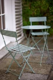 small garden bistro table and chairs cosmopolitan bistro set with shutter blue garden trading with table