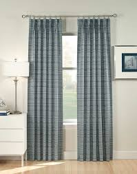 decor filigree torino pinch pleat curtains with armchair and