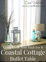 using thrift store finds for a coastal cottage buffet table casa