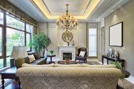 cream colored living rooms brown textured carpet cream colored sofa u shape white ceiling
