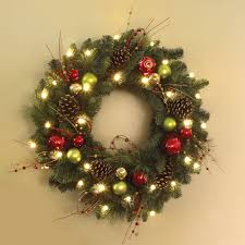 adorable image of lighted artificial gold and baubles pinecone