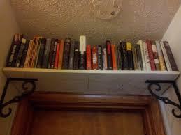 Over Door Bookshelf Considerable Bookshelf Door To Hidden Broom Closet Stashvault