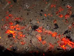 glowing ash and embers after bonfire in fireplace stock photo
