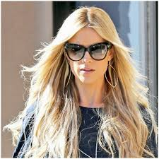 christina el moussa in our titan navette hoop earrings click to