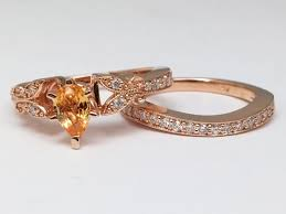 european engagement ring peach champagne sapphire butterfly