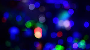 disco light background of multicolored blurred light glare disco lights