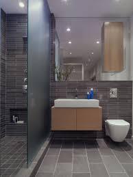 grey tiled bathroom black vanity white top in basement