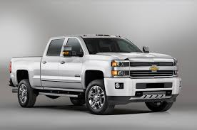 first chevy suburban gmc models cost more than chevy why and which is better