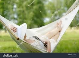 caucasian woman relaxing hammock sleeping outdoors stock photo