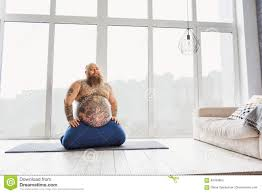 funny fat man doing yoga at home stock photo image 83784963