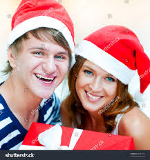young happy couple christmas hats standing stock photo 88281016