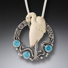 handmade silver necklace images Mammoth ivory bird necklace with blue topaz handmade silver jpg