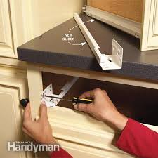 install cabinets like a pro the family handyman kitchen cabinet repair home repair how to fix kitchen cabinets the