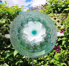 recycled glass flower yard art i love the stems that looks way