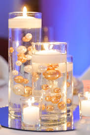 gold centerpieces floating candle centerpieces with gold and white pearls