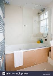 bathroom glass panel home design ideas glass shower screen on bath with pale wood panel in modern white bathroom