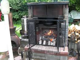 outdoor fireplace with cooking shelf cooking pizza in cast iron