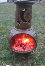 Chiminea Fire Pit How To Cook With A Chiminea Clay Fireplace U003e Hanover Koi Farms