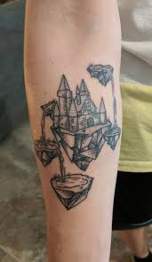 castle in the sky done by dallas davis at canvas tattoo and art