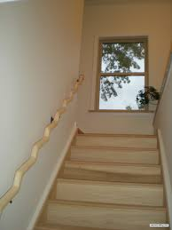 Wood Banisters And Railings Wavy Wood Banister Installed And It Looks Awesome