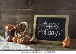 happy holidays written white chalk on stock photo 474528655