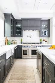 black kitchen cabinets farmhouse black beadboard kitchen cabinets with farmhouse sink