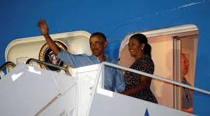 barack wears cap backwards michelle on pigtails at moskito island