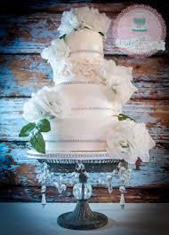 white roses and diamante wedding cake